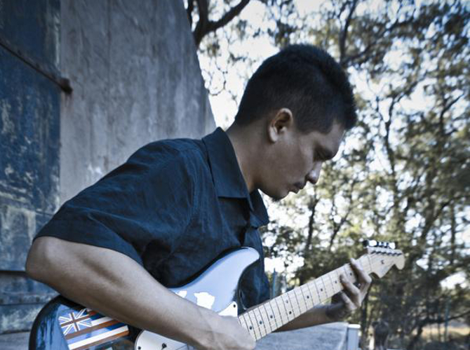 Dezman Yap on guitar