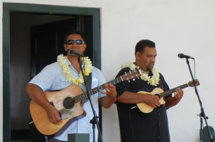 Josh Kahula and Preston Ako perform in front of Baldwin Home Museum in Lahaina