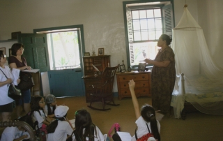 Jackie talks story on a guided tour with elementary school students in Lahaina