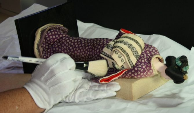 Japanese heirloom doll being cleaned