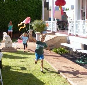 Keiki playing with kites on Friday