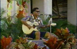 Wilson Kanaka'ole performing on guitar